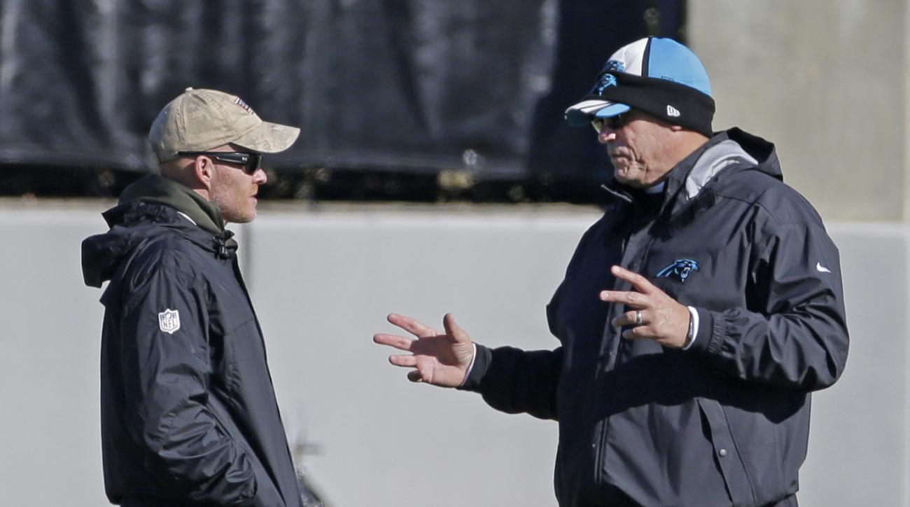 Carolina Panthers head coach Ron Rivera, right, talks with defensive coordinator Sean McDermott, left, during practice for the NFL football team in Charlotte, N.C., Thursday, Jan. 7, 2016. (AP Photo/Chuck Burton)