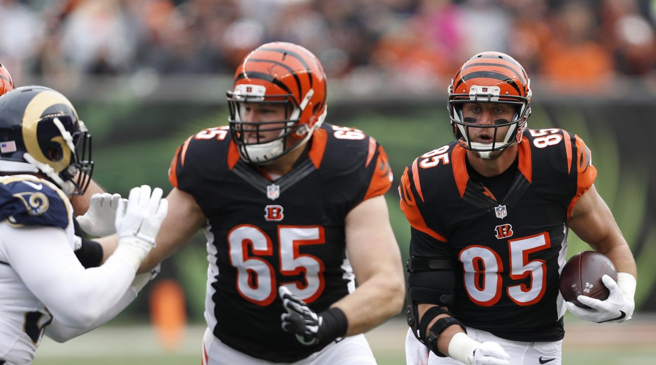 FILE - In this Nov. 29, 2015, file photo, Cincinnati Bengals tight end Tyler Eifert (85) runs the ball as guard Clint Boling (65) provides protection in the first half of an NFL football game against the St. Louis Rams, in Cincinnati. (AP Photo/Frank Vict