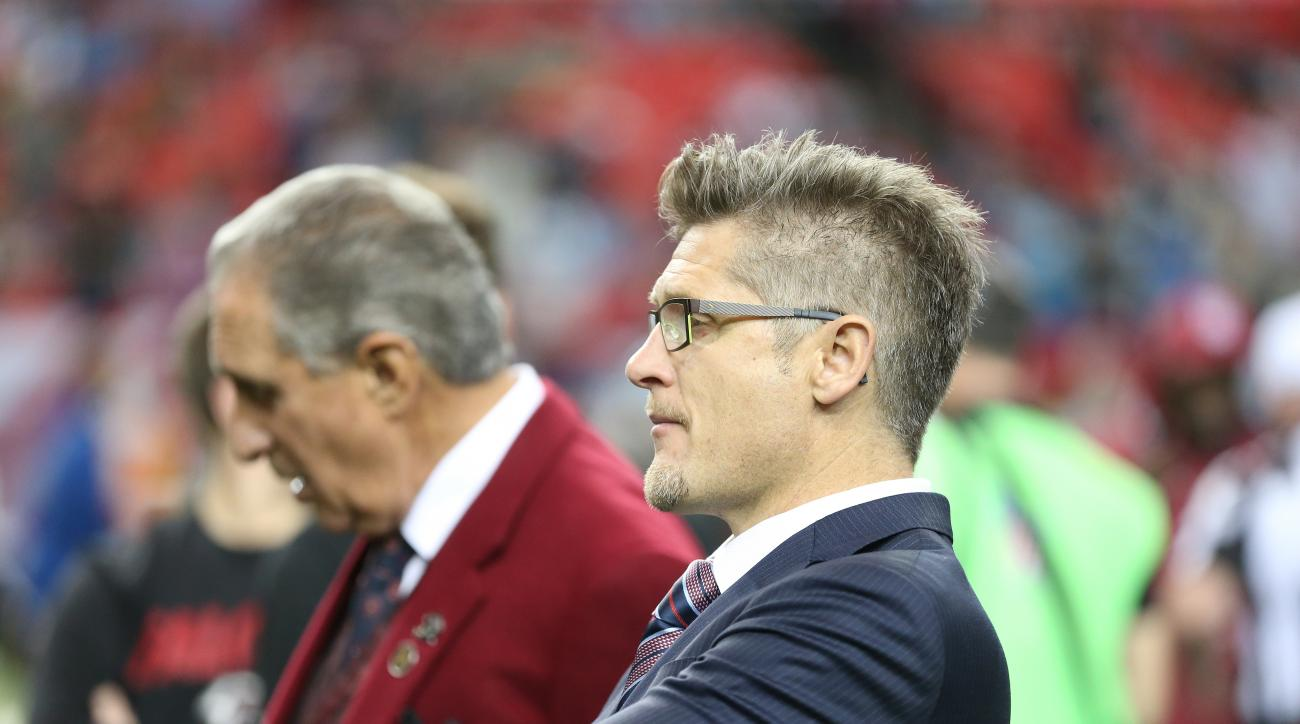 FILE - In this Dec. 27, 2015,  file photo, Atlanta Falcons General Manager Thomas Dimitroff, right, stands next to Falcons owner Arthur Blank before the first half of an NFL football game against the Carolina Panthers in Atlanta. Blank says he is sticking