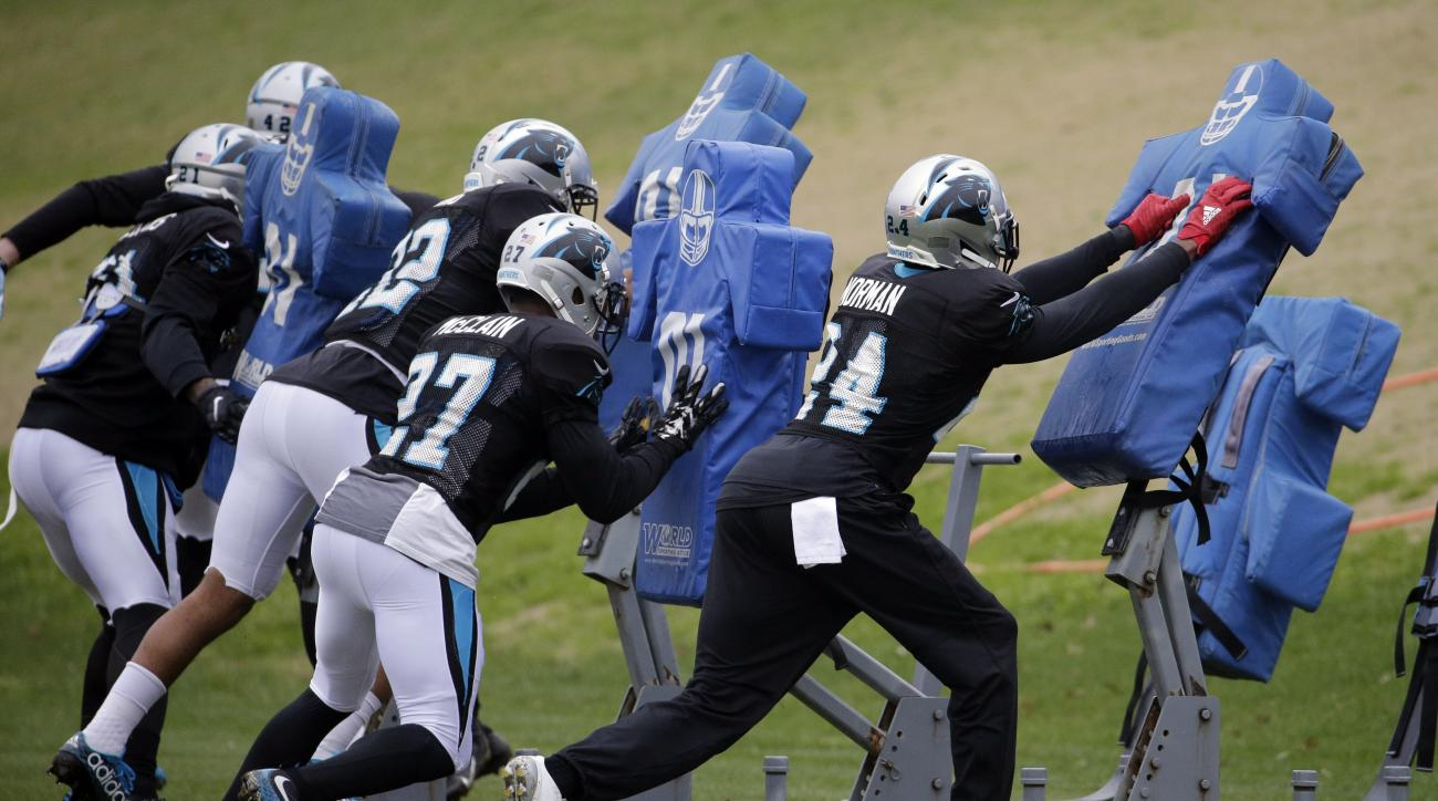 Carolina Panthers' Josh Norman (24) runs a drill during practice for the NFL football team in Charlotte, N.C., Friday, Jan. 8, 2016. (AP Photo/Chuck Burton)