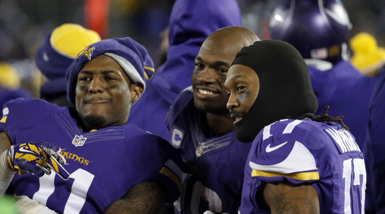 FILE - In this Dec. 27, 2015, file photo, Minnesota Vikings wide receiver Mike Wallace (11), running back Adrian Peterson (28) and wide receiver Jarius Wright (17) react on the sideline during the second half of an NFL football game against the New York G