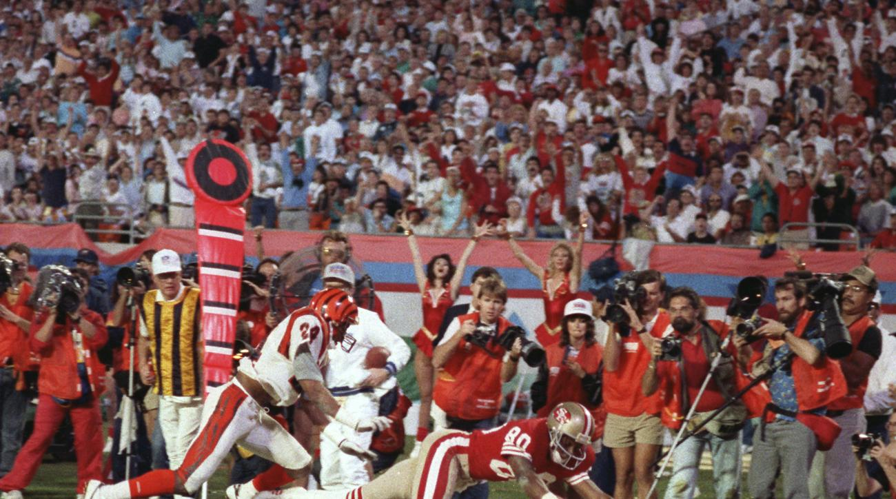 FILE - In this Jan. 22, 1989, file photo, San Francisco 49ers wide receiver Jerry Rice (80) dives into the end zone for a touchdown during the third quarter against the Cincinnati Bengals in NFL football's Super Bowl XXIII in Miami. Rice was voted the mos