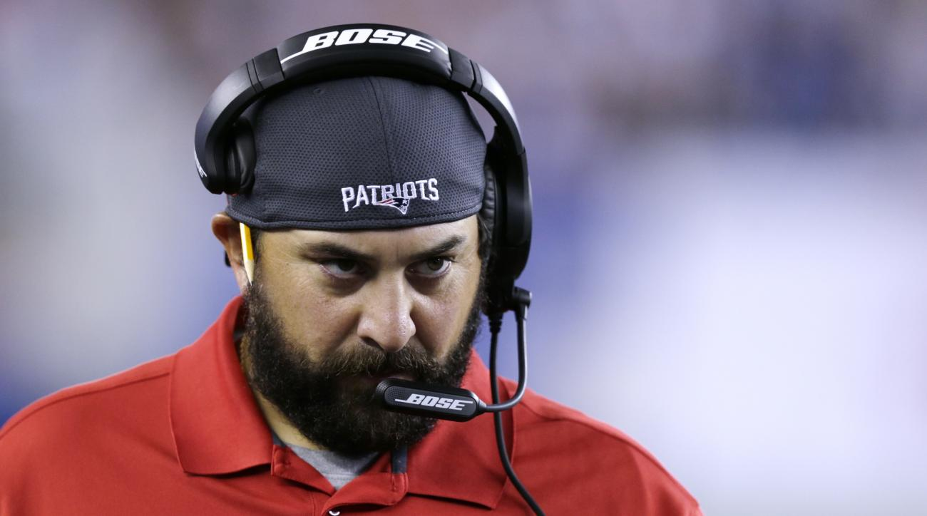 FILE - In this Aug. 22, 2014, file photo, New England Patriots defensive coordinator Matt Patricia watches from the sidelines in the first half of a preseason NFL football game against the Carolina Panthers in Foxborough, Mass. The Cleveland Browns are in