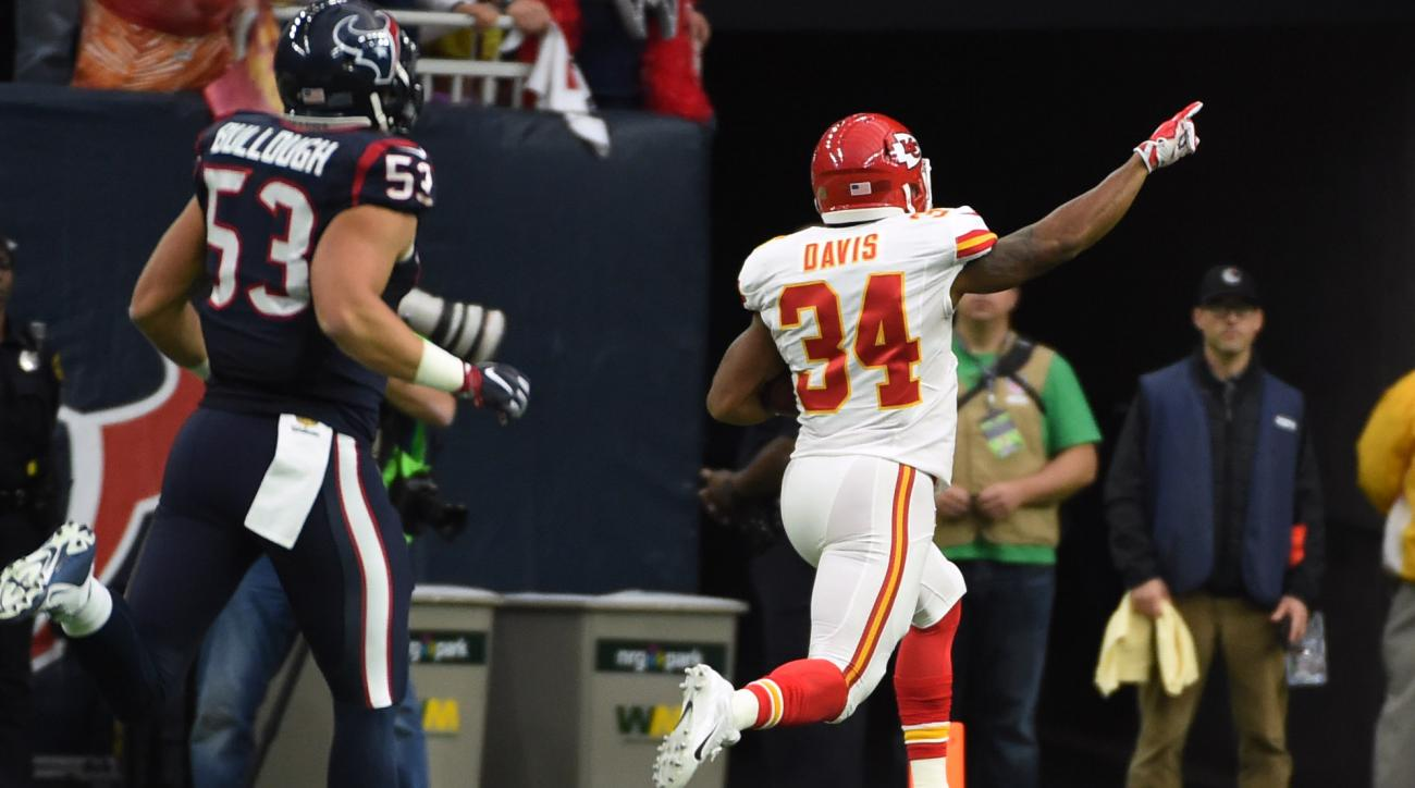 Kansas City Chiefs running back Knile Davis (34) returns a kickoff for a touchdown as Houston Texans inside linebacker Max Bullough (53) chases him during the first half of an NFL wild-card football game Saturday, Jan. 9, 2016, in Houston. (AP Photo/Eric