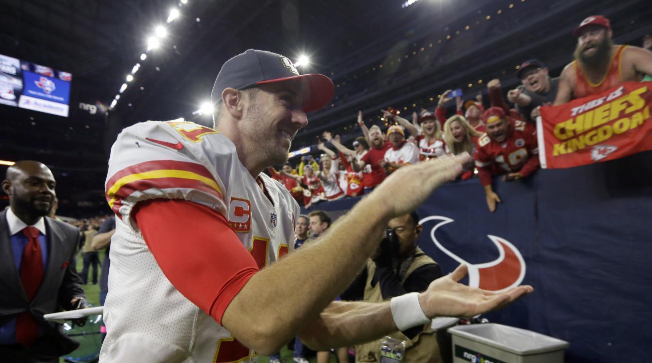 Kansas City Chiefs quarterback Alex Smith (11) runs off the field following an NFL wild-card playoff football game against the Houston Texans, Saturday, Jan. 9, 2016, in Houston. Kansas City won 30-0. (AP Photo/Tony Gutierrez)