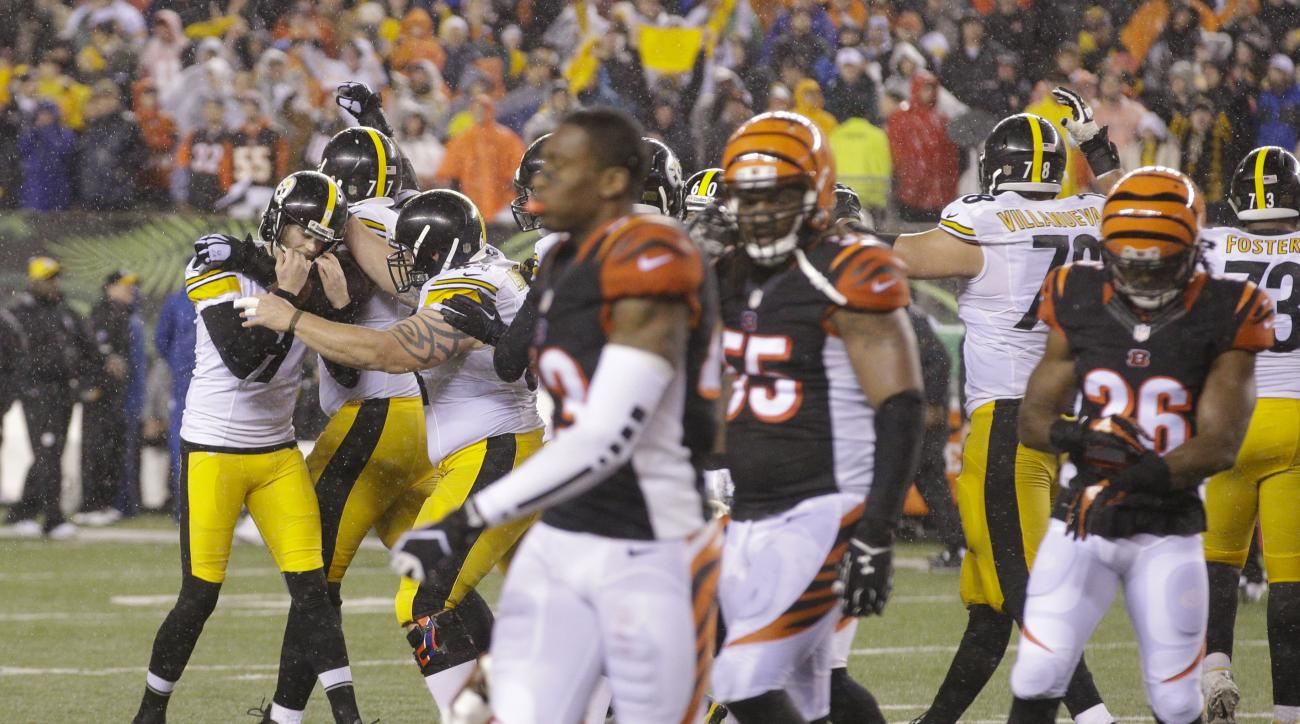 Pittsburgh Steelers' Chris Boswell (9) celebrates with teammates after kicking a 35-yard game winning field goal during the second half of an NFL wild-card playoff football game against the Cincinnati Bengals, Sunday, Jan. 10, 2016, in Cincinnati. Pittsbu