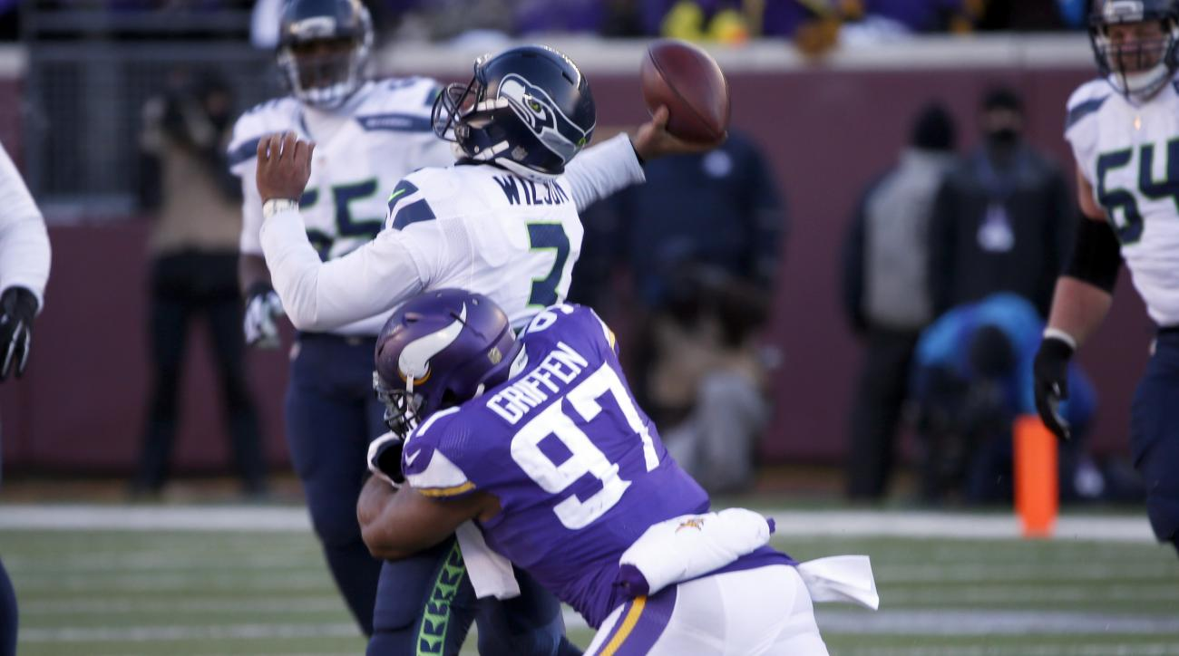 Minnesota Vikings defensive end Everson Griffen (97) tackles Seattle Seahawks quarterback Russell Wilson (3) as Wilson throws during the second half of an NFL wild-card football game, Sunday, Jan. 10, 2016, in Minneapolis. (AP Photo/Jim Mone)