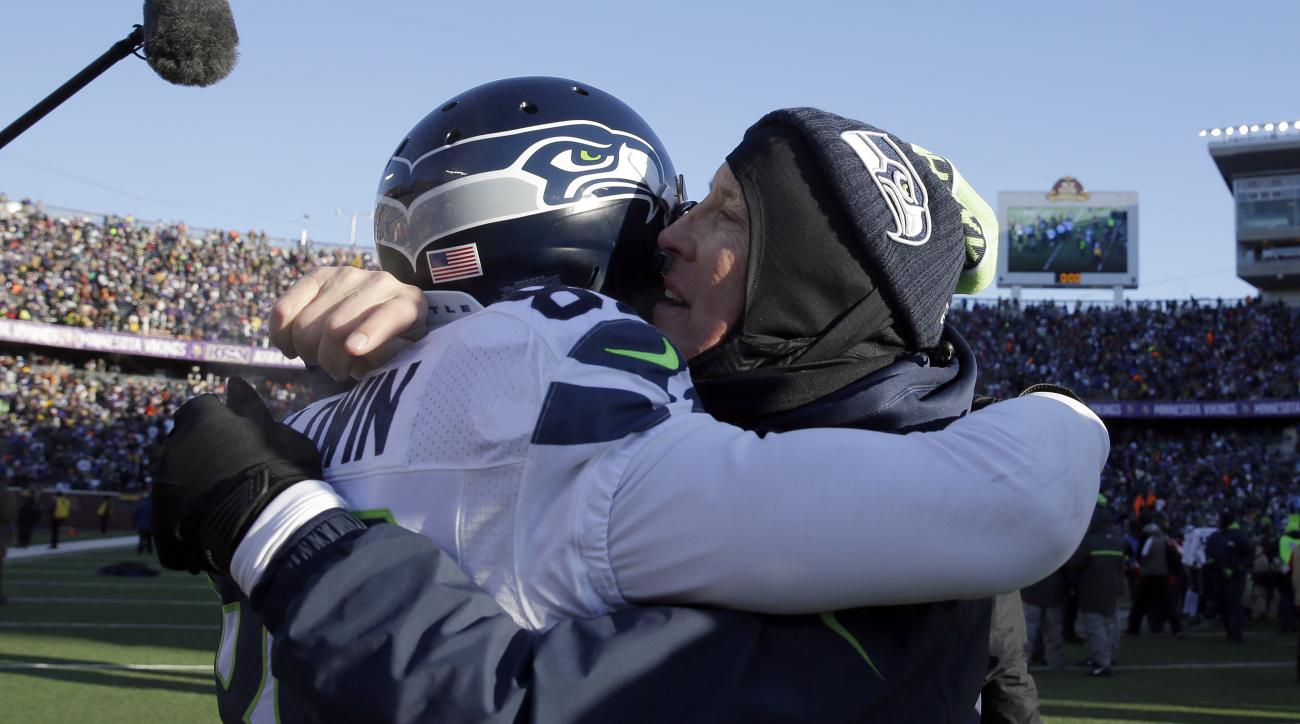 Seattle Seahawks head coach Pete Carroll celebrates with wide receiver Doug Baldwin (89) after an NFL wild-card football game, Sunday, Jan. 10, 2016, in Minneapolis. The Seahawks won 10-9. (AP Photo/Nam Y. Huh)