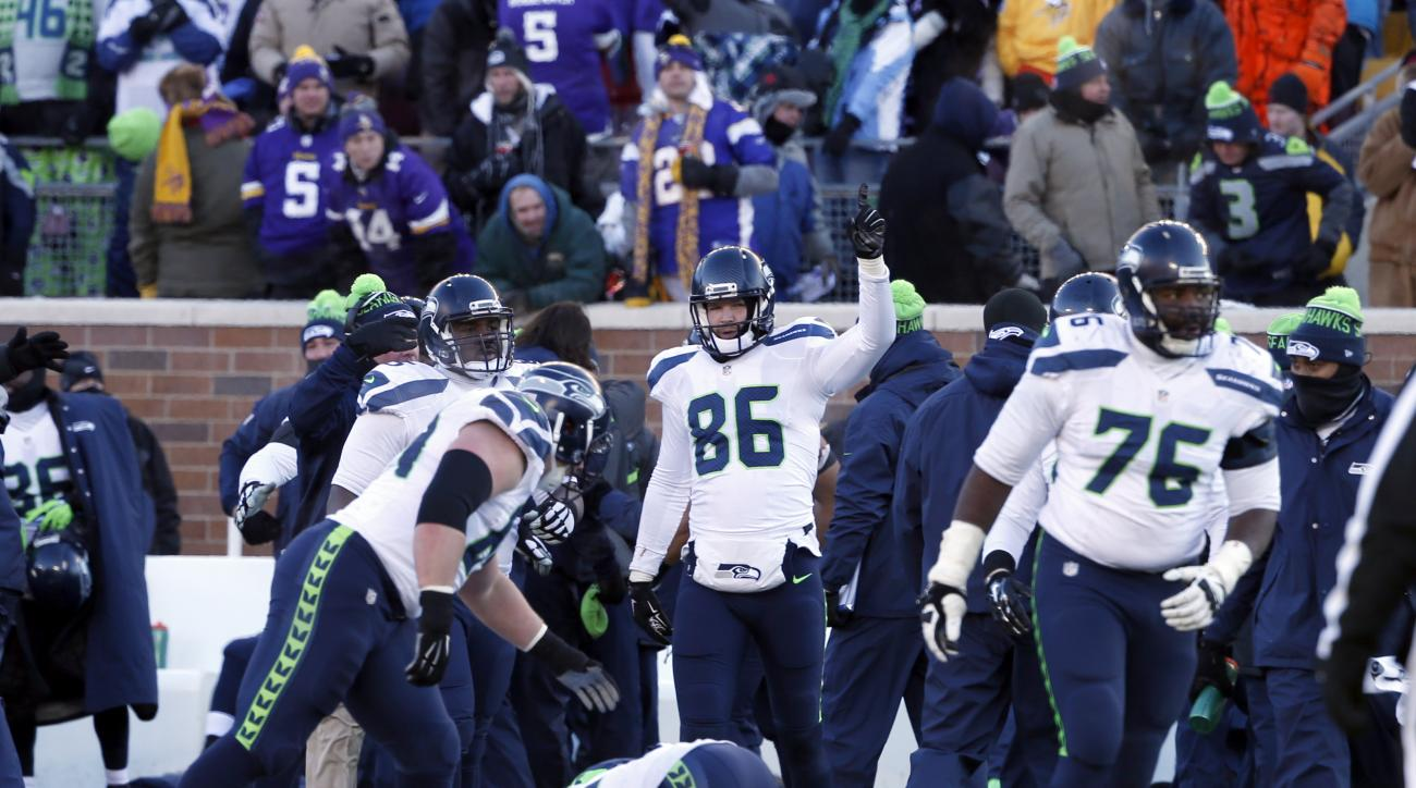 Seattle Seahawks players celebrate after Minnesota Vikings kicker Blair Walsh (3) misses a field goal during the second half of an NFL wild-card football game, Sunday, Jan. 10, 2016, in Minneapolis. The Seahawks won 10-9. (AP Photo/Jim Mone)