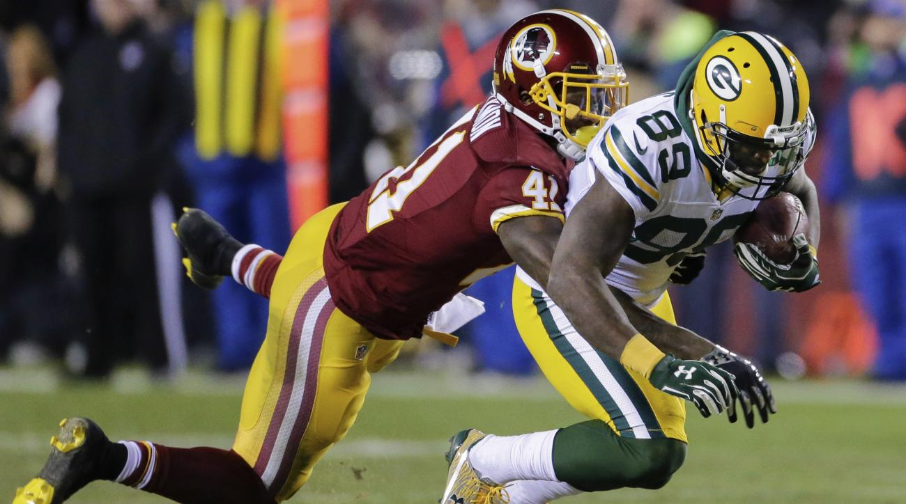 Green Bay Packers wide receiver James Jones (89) is knocked to the turf by Washington Redskins cornerback Will Blackmon (41) during the first half of an NFL wild card playoff football game in Landover, Md., Sunday, Jan. 10, 2016. (AP Photo/Mark Tenally)
