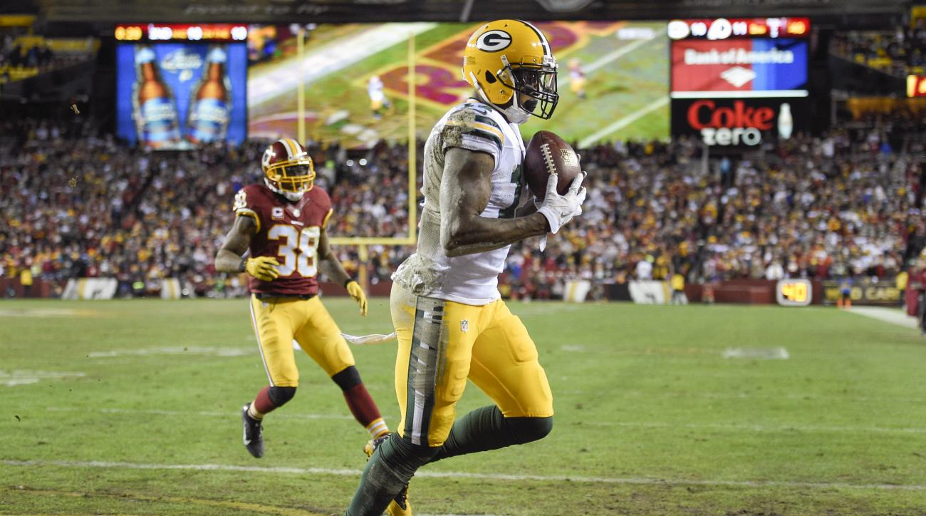 Green Bay Packers wide receiver Davante Adams (17) pulls in a touchdown pass as Washington Redskins free safety Dashon Goldson (38) closes in during the first half of an NFL wild card playoff football game in Landover, Md., Sunday, Jan. 10, 2016. (AP Phot