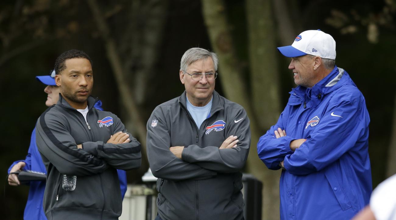 Buffalo Bills head coach Rex Ryan, right, talks with team owner Terry Pegula, center, and team manager Doug Whaley during an NFL training session at the Grove Hotel in Chandler's Cross, England, Thursday, Oct. 22, 2015. The Buffalo Bills play the Jacksonv