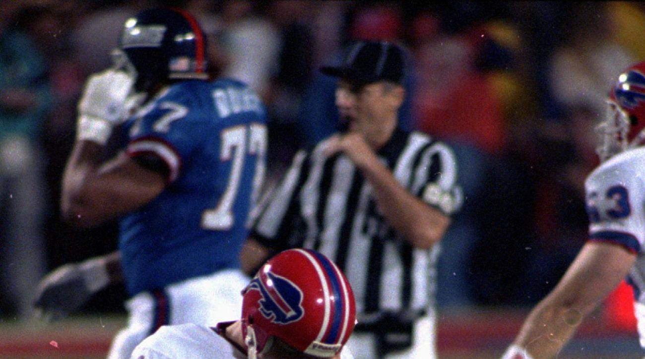 FILE- In this Jan. 27, 1991, file photo, Buffalo Bills' Scott Norwood walks off the field after missing what would have been the game-winning field goal in the NFL football Super Bowl XXV against the New York Giants in Tampa. The Giants won 20-19. (AP Pho