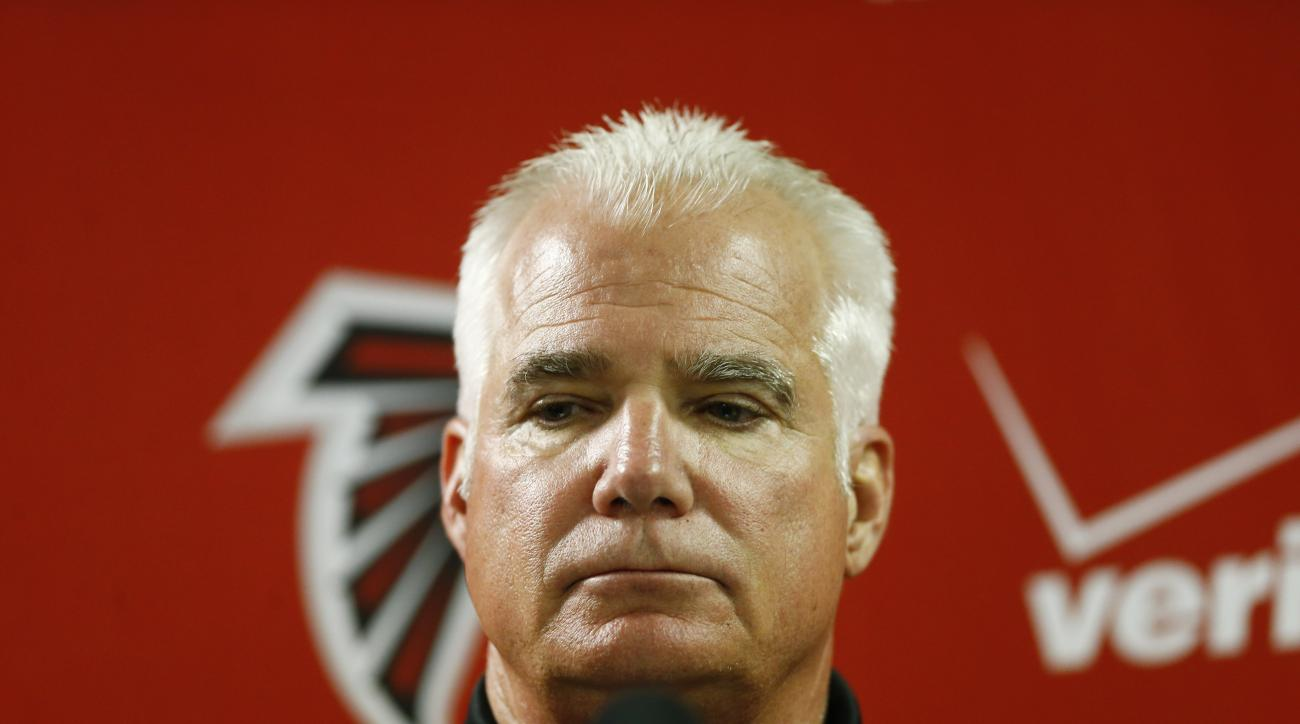 In this Sunday, Dec. 28, 2014 photo, Atlanta Falcons head coach Mike Smith speaks at a news conference after the second half of an NFL football game against the Carolina Panthers, in Atlanta. On Monday, Dec. 29, 2014, the Atlanta Falcons fired Smith, one