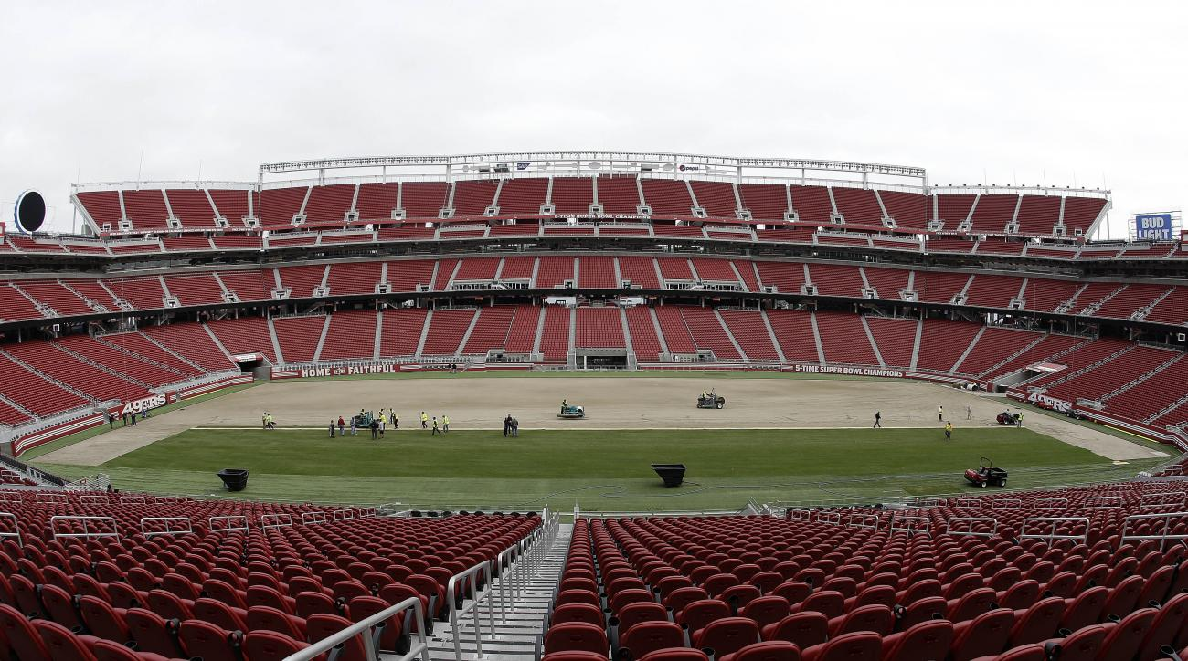 In this photo taken with a fisheye lens, workers install sod on the field at Levi's Stadium in preparation for the NFL's Super Bowl 50 in Santa Clara, Calif., Monday, Jan. 11, 2016. Less than four weeks out from the Super Bowl, the field is nearly ready t