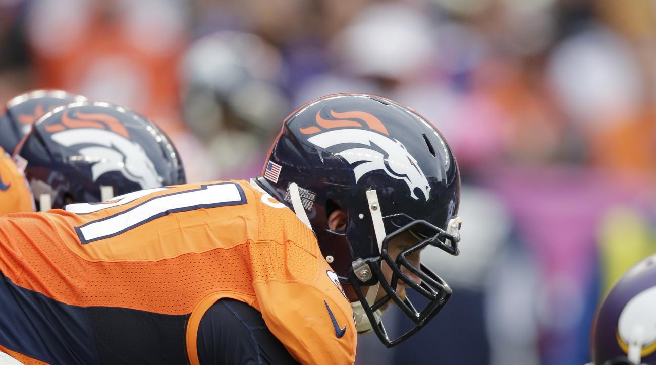 FILE - In this Oct. 4, 2015, file photo, Denver Broncos center Matt Paradis lines up during an NFL football game between the Broncos and the Minnesota Vikings, in Denver. The Broncos' offensive line has resembled both a carousel and a turnstile. The only