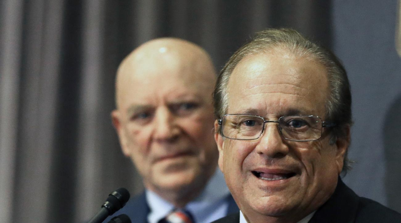 Houston Texans owner Bob McNair, left, listens as San Diego Chargers owner Dean Spanos talks to the media after team owners voted Tuesday, Jan. 12, 2016, in Houston to allow the St. Louis Rams to move to a new stadium just outside Los Angeles, and the Cha
