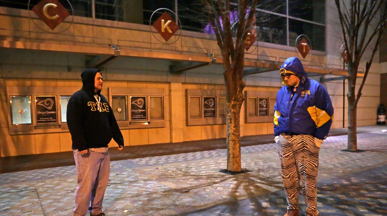 Zach Remelius, left, Mickey Right stand outside the Edward Jones Dome on Tuesday, Jan. 12, 2016, in St. Louis. NFL owners voted Tuesday night to allow the St. Louis Rams to move to a new stadium at a site just outside Los Angeles, and the San Diego Charge