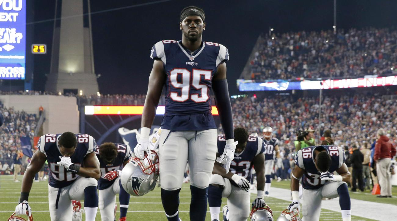 FILE - In this Oct. 29, 2015 file photo, New England Patriots defensive end Chandler Jones walks in the end zone before an NFL football game against the Miami Dolphins in Foxborough, Mass. Jones was admitted to a hospital on Sunday, Jan. 10, 2016, and rel