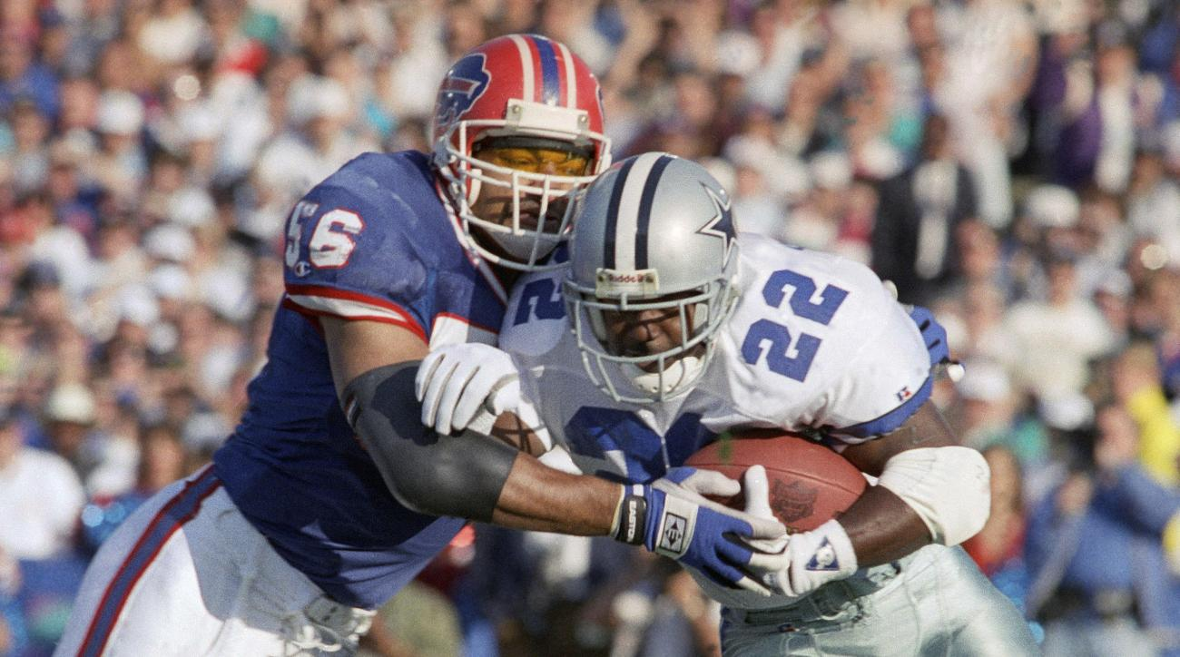 FILE - In this Jan. 31, 1993, file photo, Dallas Cowboys'  Emmitt Smith (22) gains yardage on Buffalo Bills' Darryl Talley during the first quarter of NFL football's Super Bowl XXVII in Pasadena, Calif. Smith rushed for 108 yards as Dallas won 52-17. (AP