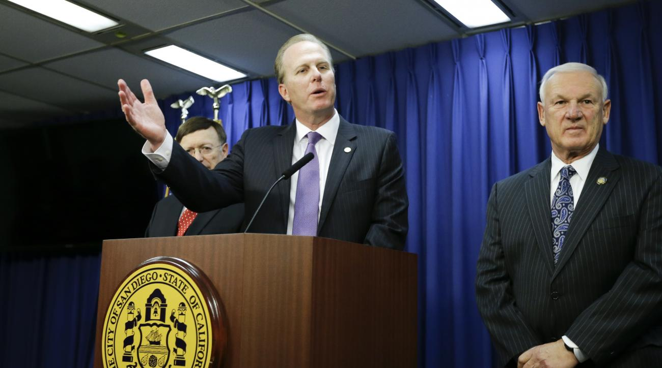San Diego Mayor Kevin Faulconer, center, speaks during a news conference about the city's NFL football team alongside Ron Roberts, chairman of the San Diego County Board of Supervisors, and City Attorney Jan Goldsmith, left,  Wednesday, Jan. 13, 2016, in