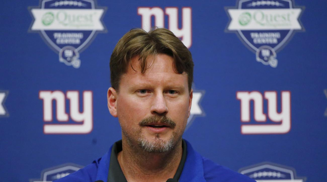 FILE - In this June 18, 2015, file photo, New York Giants offensive coordinator Ben McAdoo talks to reporters during NFL football minicamp in East Rutherford, N.J. A person familiar with the decision tells The Associated Press the Giants are hiring offens