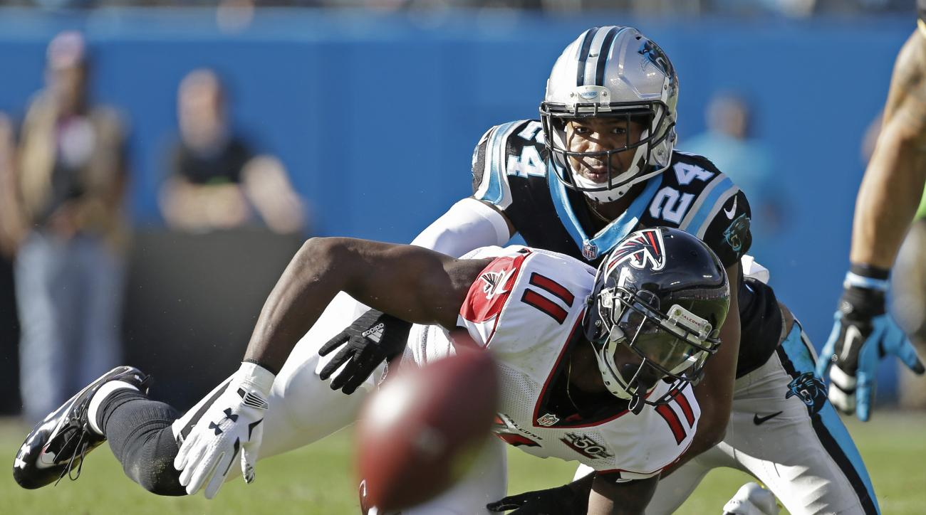 FILE - In this Dec. 13, 2015, file photo, Carolina Panthers' Josh Norman (24) defends on an incomplete pass to Atlanta Falcons' Julio Jones (11) during an NFL football game in Charlotte, N.C. The Panthers play the Seattle Seahawks in a playoff game Sunday