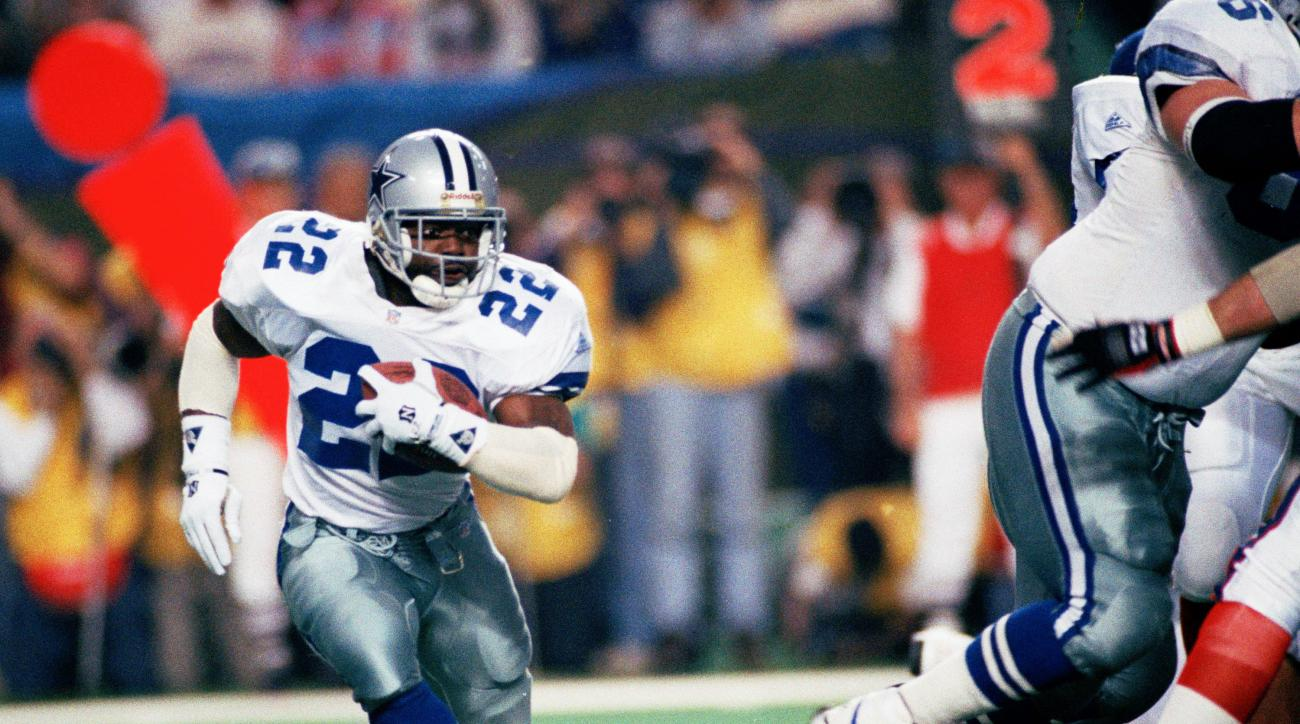 FILE - In this Sunday, Jan. 30, 1994 file photo, Dallas Cowboys running back Emmitt Smith (22) runs for short yardage against the Buffalo Bills during Super Bowl XXVIII action at the Georgia Dome in Atlanta. Smith rushed for 132 yards as Dallas defeated B