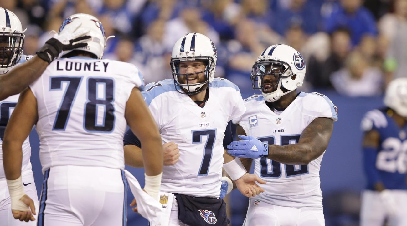 Tennessee Titans quarterback Zach Mettenberger (7) celebrates a touchdown with center Joe Looney (78) and tight end Delanie Walker (82) during the first half of an NFL football game against the Indianapolis Colts in Indianapolis, Sunday, Jan. 3, 2016. (AP