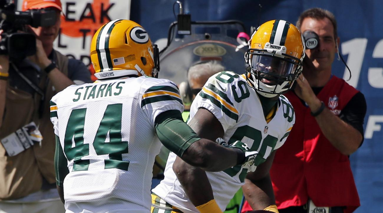 FILE - In this Sept. 13, 2015, file photo, Green Bay Packers wide receiver James Jones (89) celebrates a touchdown with running back James Starks (44) during the first half an NFL football game against the Chicago Bears in Chicago. In his nine seasons in
