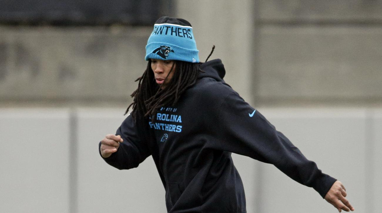 FILE - In this Jan. 8, 2016, file photo, Carolina Panthers' Kelvin Benjamin runs across the field during practice for the NFL football team in Charlotte, N.C. Panthers wide receiver Kelvin Benjmain has been relegated to cheerleader this year after tearing