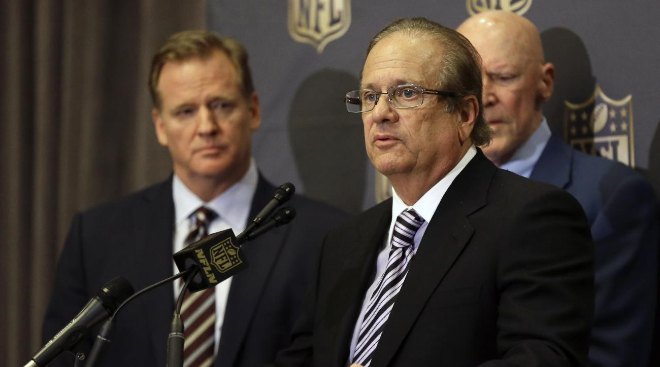 FILE - In this Jan. 12, 2016, file photo, NFL Commissioner Roger Goodell, left, listens as San Diego Chargers owner Dean Spanos talks to the media after team owners voted in Houston to allow the St. Louis Rams to move to a new stadium just outside Los Ang