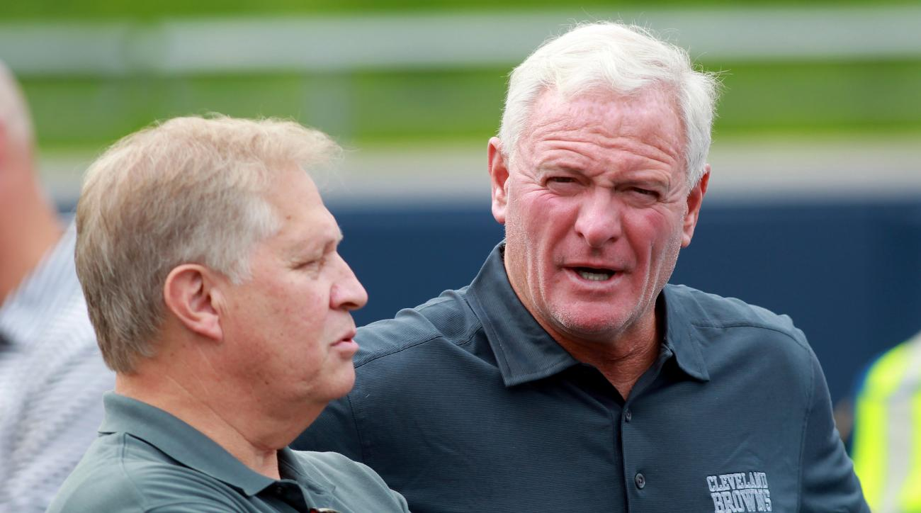 Cleveland Browns owner Jimmy Haslam (right) talks with ESPN's Chris Mortensen at the NFL football team's training camp that was held at InfoCision Stadium in Akron, Ohio, Saturday Aug. 2, 2014. (AP Photo/Aaron Josefczyk)