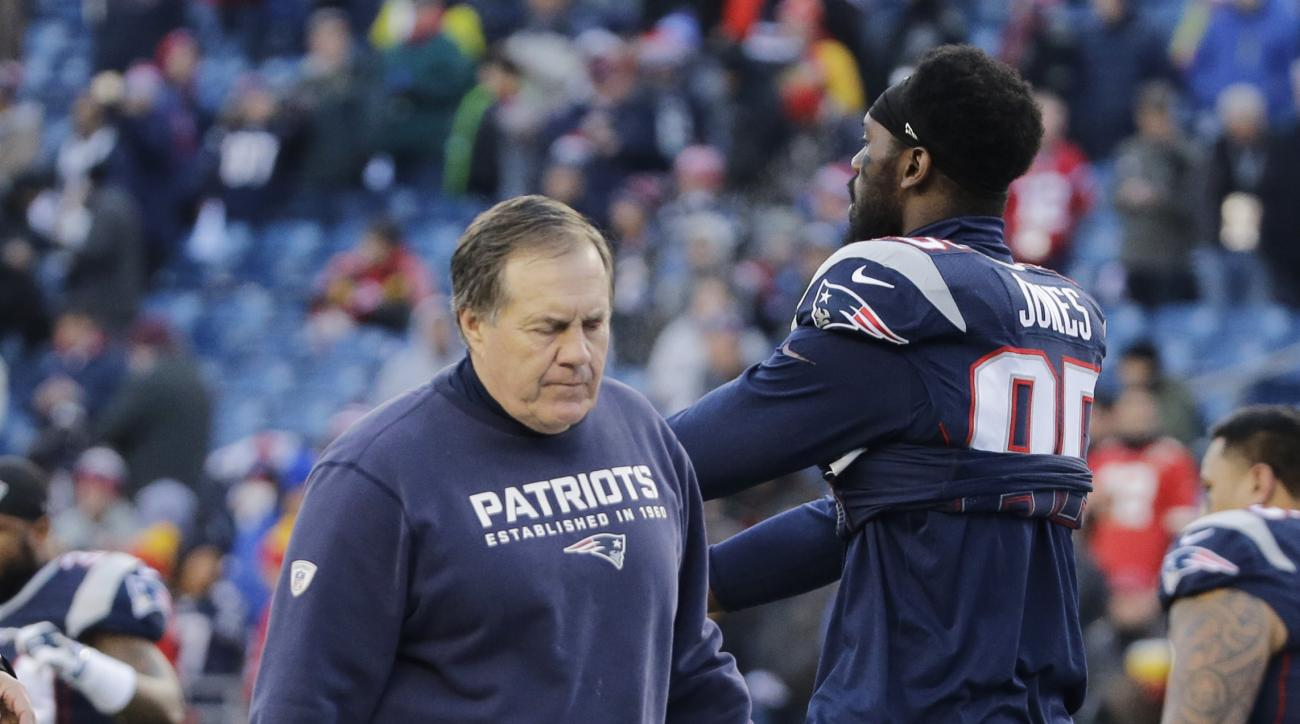 New England Patriots head coach Bill Belichick walks past New England Patriots defensive end Chandler Jones (95) as the team warms up before an NFL divisional playoff football game against the Kansas City Chiefs, Saturday, Jan. 16, 2016, in Foxborough, Ma
