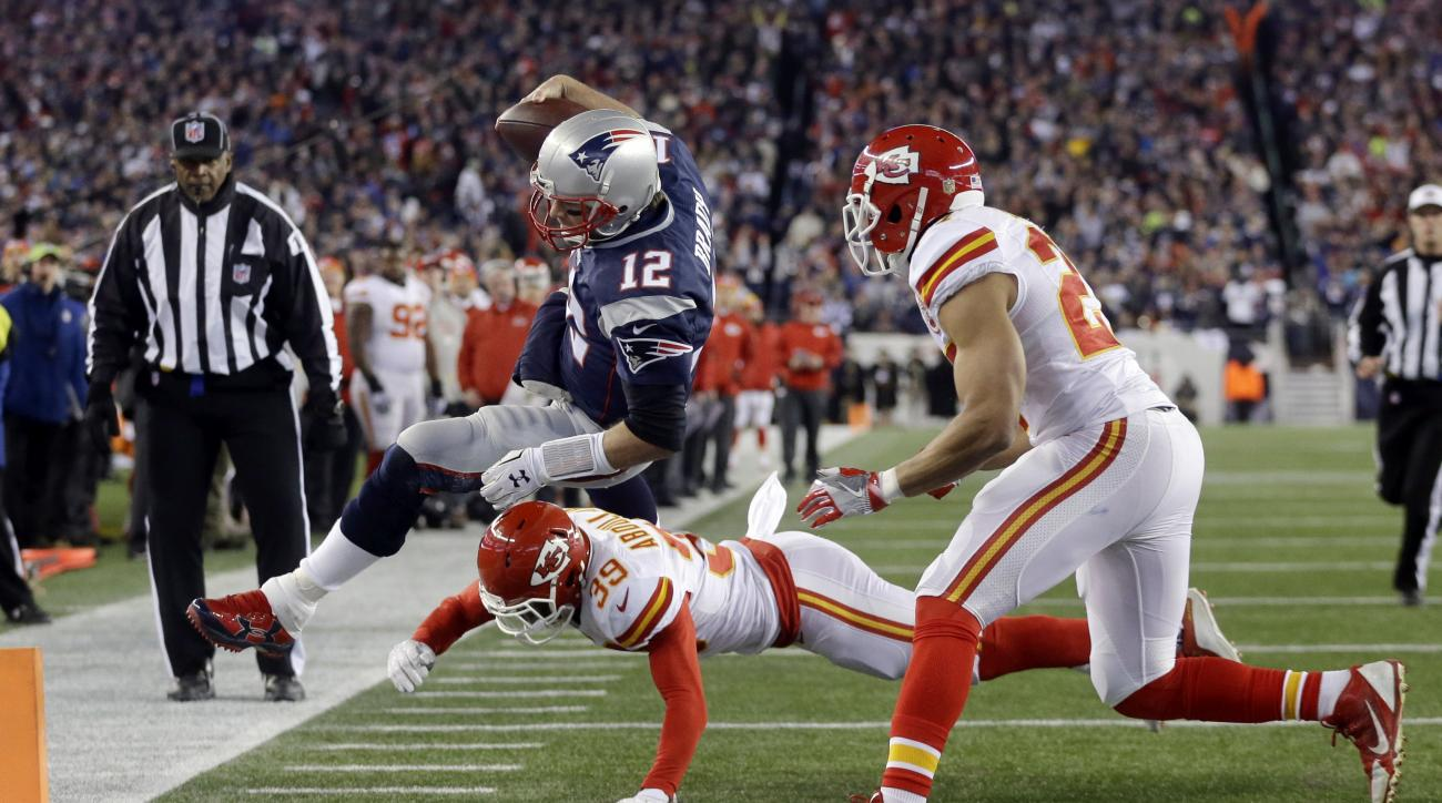 Kansas City Chiefs free safety Husain Abdullah (39) pushes New England Patriots quarterback Tom Brady (12) out of bounds short of the goal line in the first half of an NFL divisional playoff football game, Saturday, Jan. 16, 2016, in Foxborough, Mass. (AP