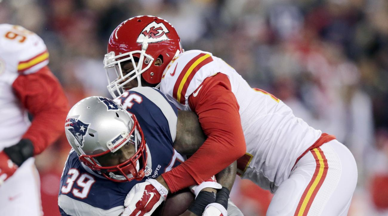 Kansas City Chiefs cornerback Sean Smith (21) and defensive back Tyvon Branch (27) tackle New England Patriots running back Steven Jackson (39) in the first half of an NFL divisional playoff football game, Saturday, Jan. 16, 2016, in Foxborough, Mass. (AP