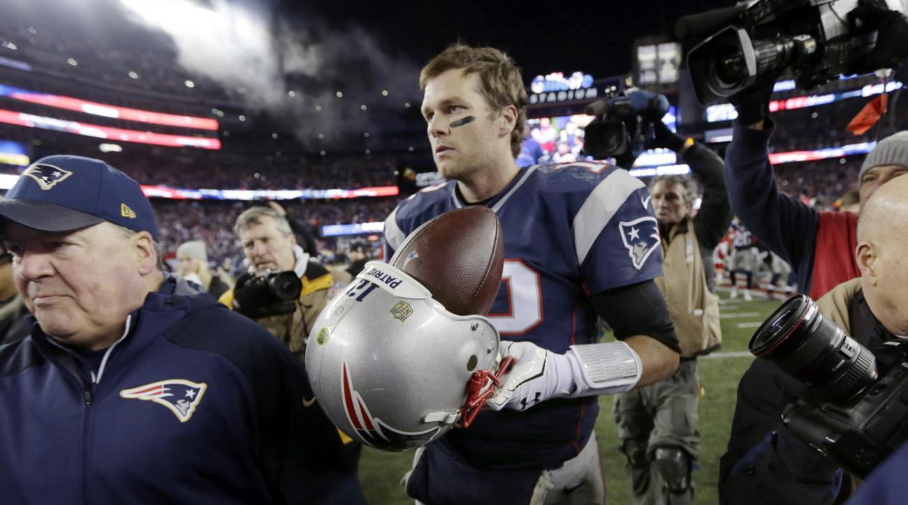 New England Patriots quarterback Tom Brady (12) leaves the field after an NFL divisional playoff football game against the Kansas City Chiefs, Saturday, Jan. 16, 2016, in Foxborough, Mass. The Patriots won 27-20. (AP Photo/Charles Krupa)