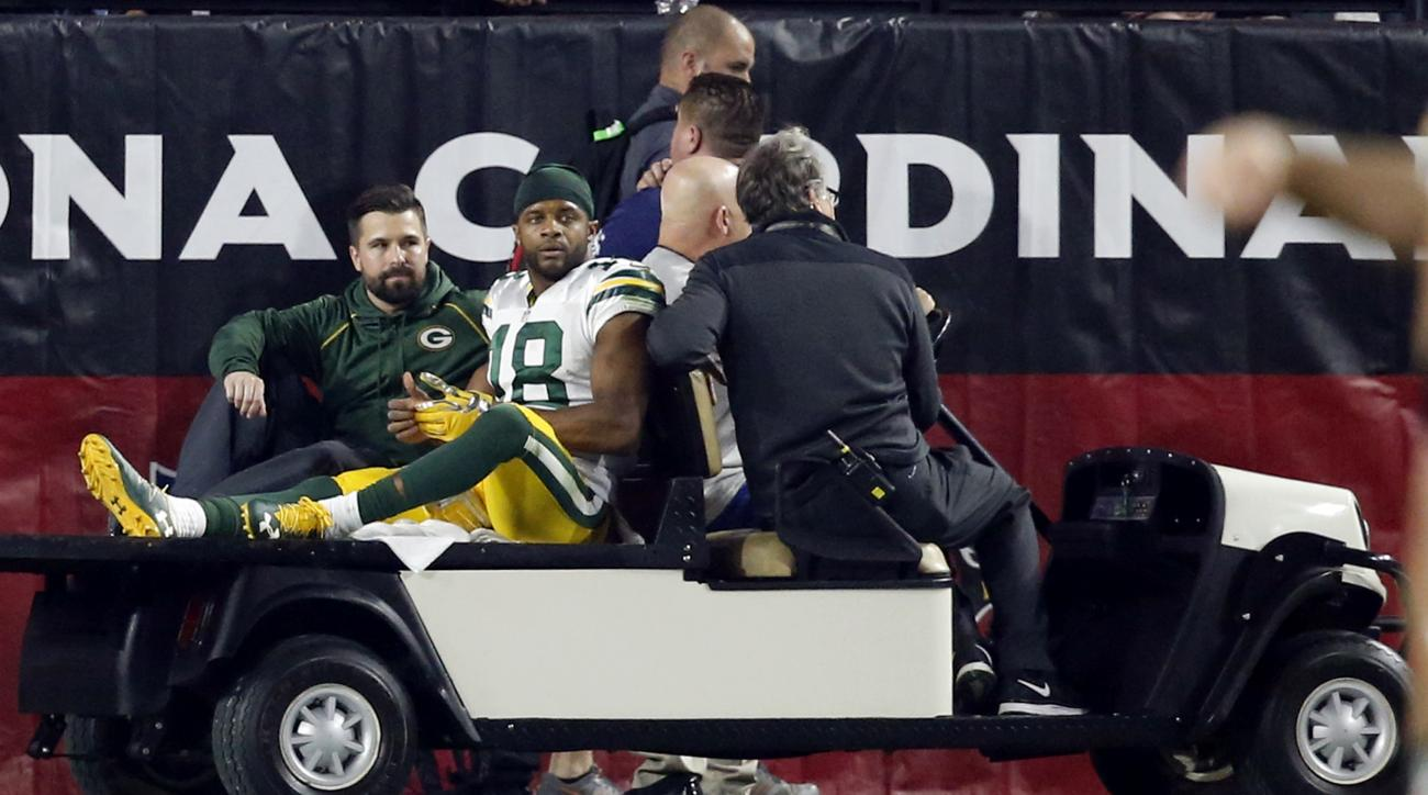 Green Bay Packers wide receiver Randall Cobb (18) is carted off the field after being injured against the Arizona Cardinals during the first half of an NFL divisional playoff football game, Saturday, Jan. 16, 2016, in Glendale, Ariz. (AP Photo/Ross D. Fra