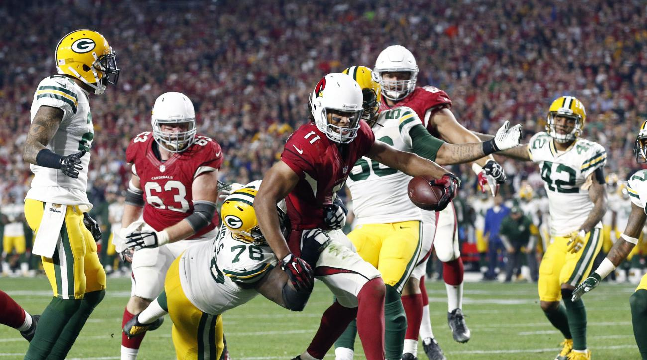 Arizona Cardinals wide receiver Larry Fitzgerald (11) scores the game-winning touchdown against the Green Bay Packers during overtime of an NFL divisional playoff football game, Saturday, Jan. 16, 2016, in Glendale, Ariz. The Cardinals won 26-20 in overti