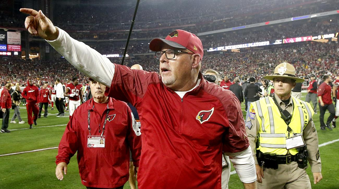 Arizona Cardinals head coach Bruce Arians celebrates after an NFL divisional playoff football game against the Green Bay Packers, Saturday, Jan. 16, 2016, in Glendale, Ariz. The Cardinals won 26-20 in overtime. (AP Photo/Ross D. Franklin)