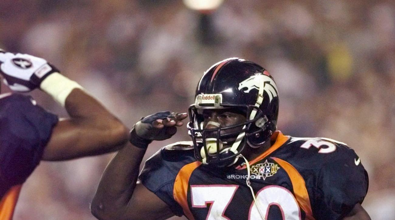 FILE - In this Jan. 25, 1998, file photo, Denver Broncos running back Terrell Davis salutes after his third quarter touchdown during Super Bowl XXXII at San Diego's Qualcomm Stadium Sunday, Jan. 25, 1998. Davis rushed for 157 yards and a record three touc