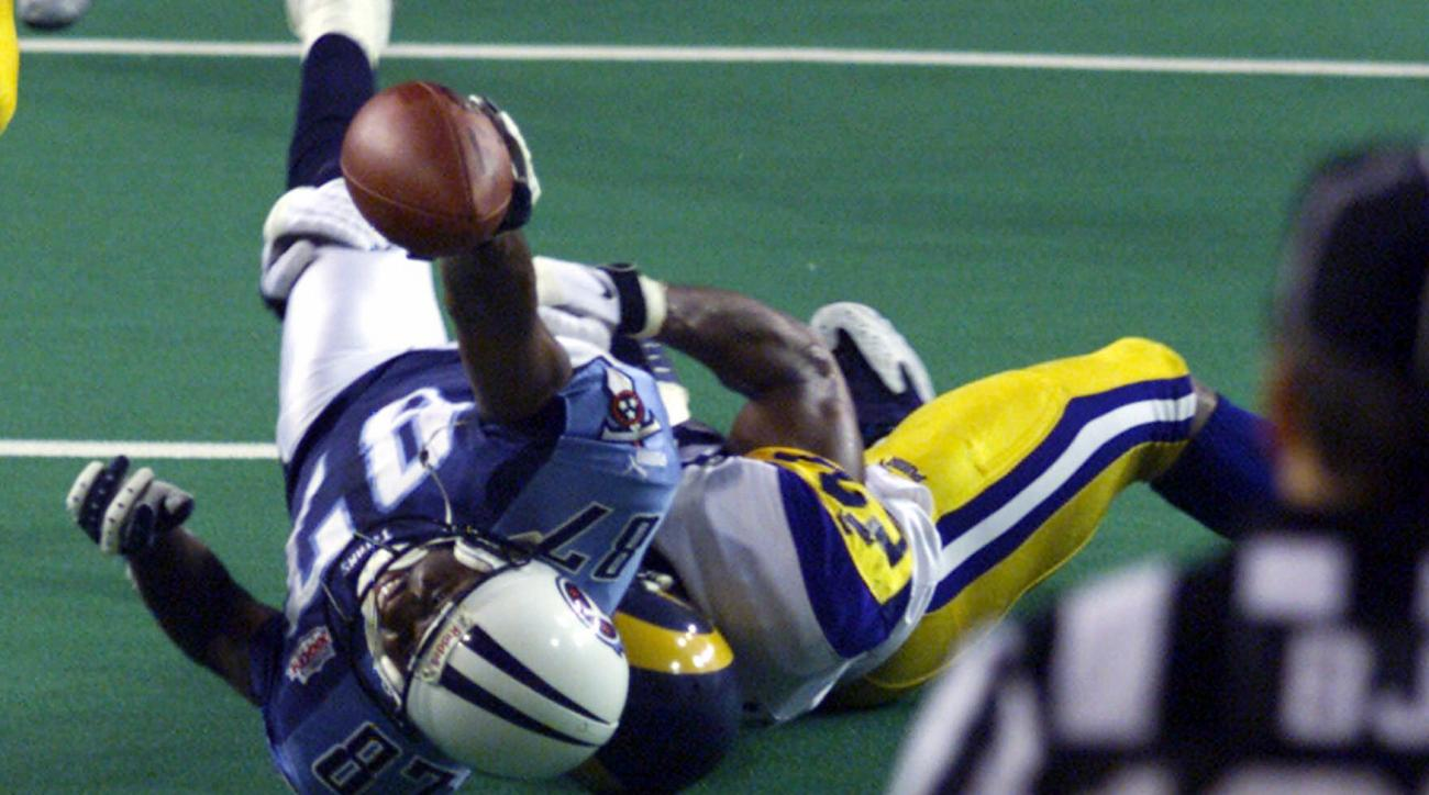 FILE - In this Jan. 30, 2000, file photo, Tennessee Titans wide receiver Kevin Dyson (87) is tackled short of the goal line by St. Louis Rams linebacker Mike Jones on the final play of NFL football's Super Bowl XXXIV to preserve the Rams' 23-16 win in Atl