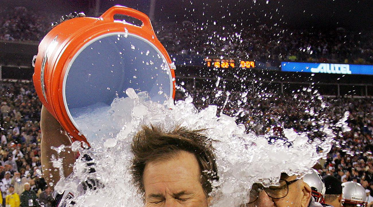 FILE - In this Feb. 6, 2005, file photo. New England Patriots coach Bill Belichick, with his father, Steve, at his side, is doused as the Patriots defeat the Philadelphia Eagles 24-21 in NFL football's Super Bowl XXXIX in Jacksonville, Fla. It was Belichi