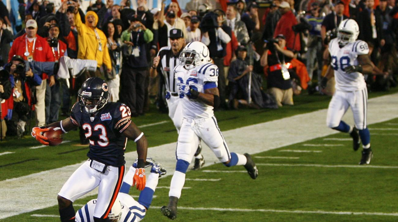 FILE - In this Feb. 4, 2007, file photo, Chicago Bears cornerback Devin Hester (23) scores on a 92-yard kickoff return against the Indianapolis Colts to open NFL football's Super Bowl XLI football game in Miami. The Colts won 29-17. (AP Photo/Kevork Djans