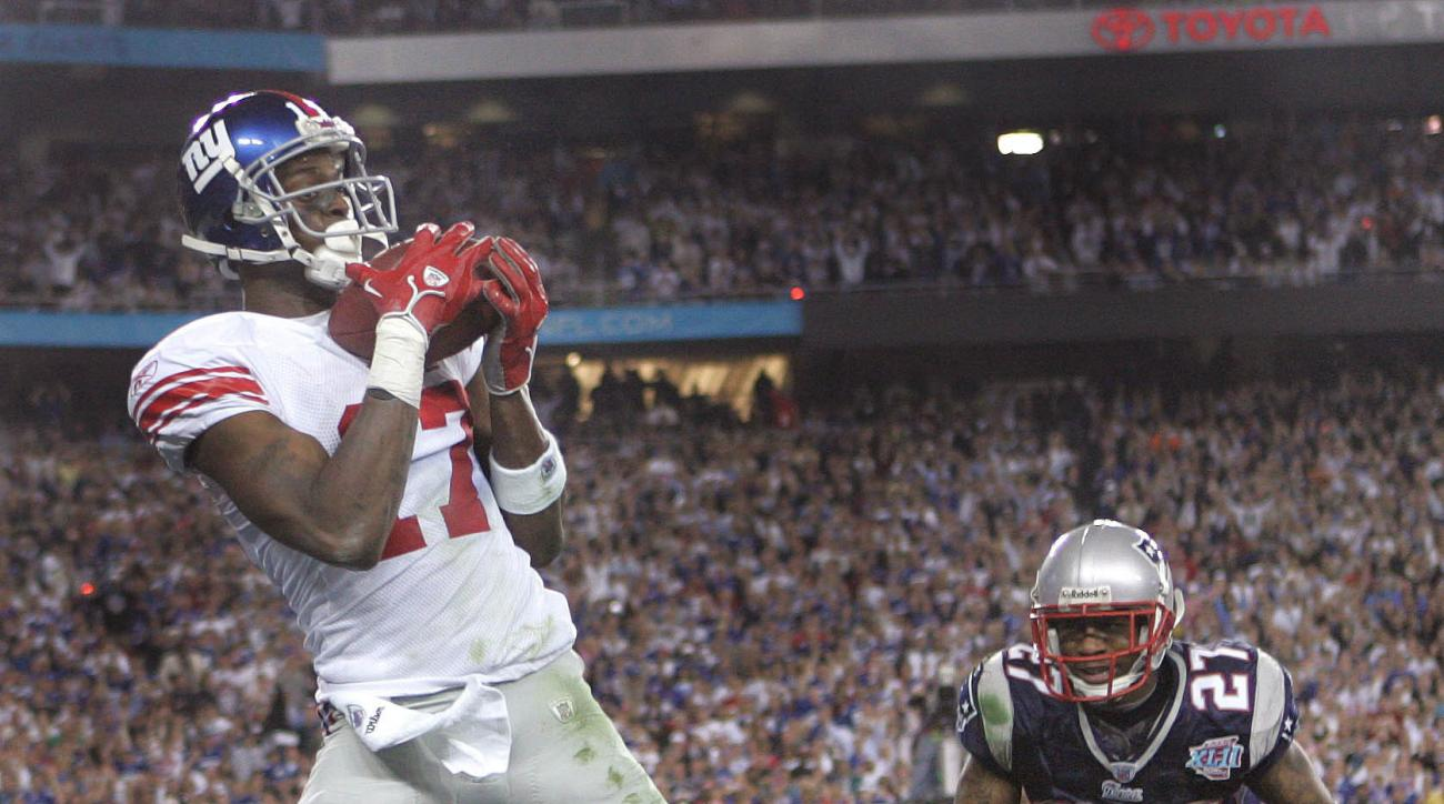 FILE - In this Feb. 3, 2008, file photo, New York Giants receiver Plaxico Burress, left, catches the game-winning touchdown pass in front of New England Patriots' Ellis Hobbs III during the final minute of NFL football's Super Bowl XLII in Glendale, Ariz.