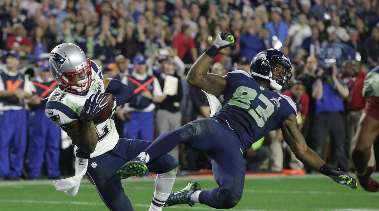 FILE - In this Feb. 1, 2015, file photo, New England Patriots cornerback Malcolm Butler (21) intercepts a pass intended for Seattle Seahawks wide receiver Ricardo Lockette (83) during the second half of the NFL Super Bowl XLIX football game, in Glendale,