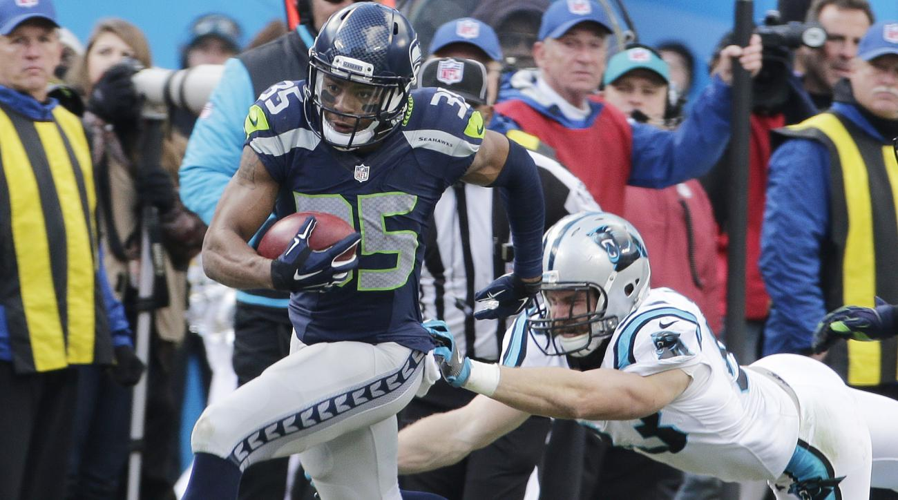 FILE - In this Jan. 17, 2016, file photo, Seattle Seahawks cornerback DeShawn Shead (35) runs past Carolina Panthers linebacker Ben Jacobs (53) during the second half of an NFL divisional playoff football game, in Charlotte, N.C. The Panthers problem this