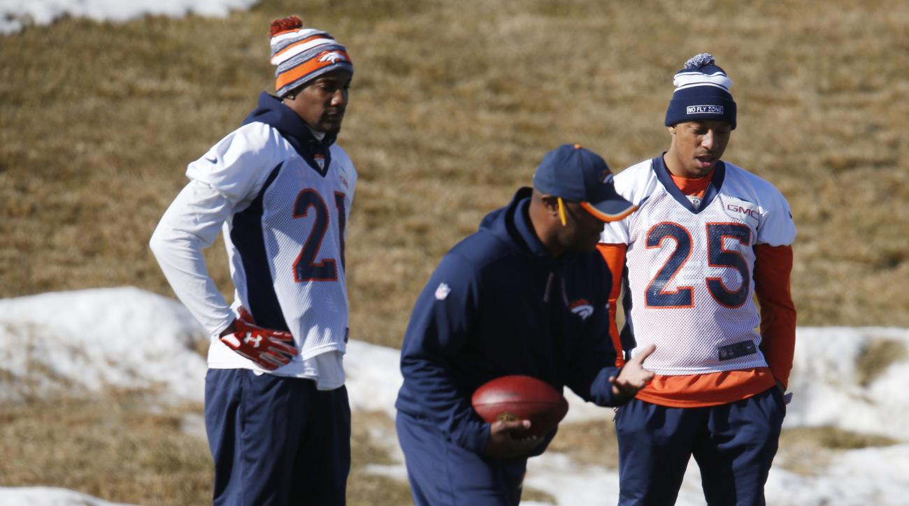 Denver Broncos cornerback Aqib Talib, left, and Denver Broncos cornerback Chris Harris, right, listen to a coach during an NFL football practice Wednesday, Jan. 20, 2016, at the team's headquarters in Englewood, Colo. The Broncos will host the New England
