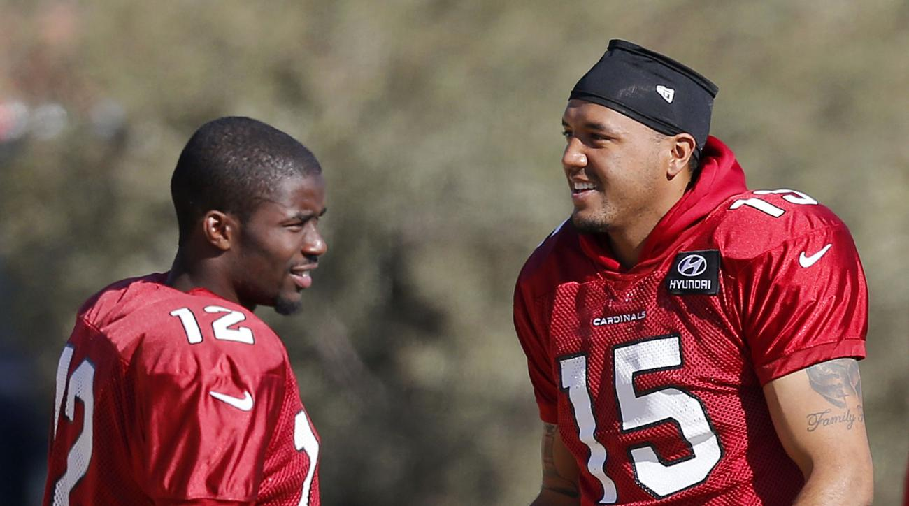 Arizona Cardinals' Michael Floyd (15) talks with John Brown (12) during NFL football practice at Cardinals training facility Wednesday, Jan. 20, 2016, in Tempe, Ariz.  The Cardinals will face the Carolina Panthers in the NFC Championship game on Sunday in
