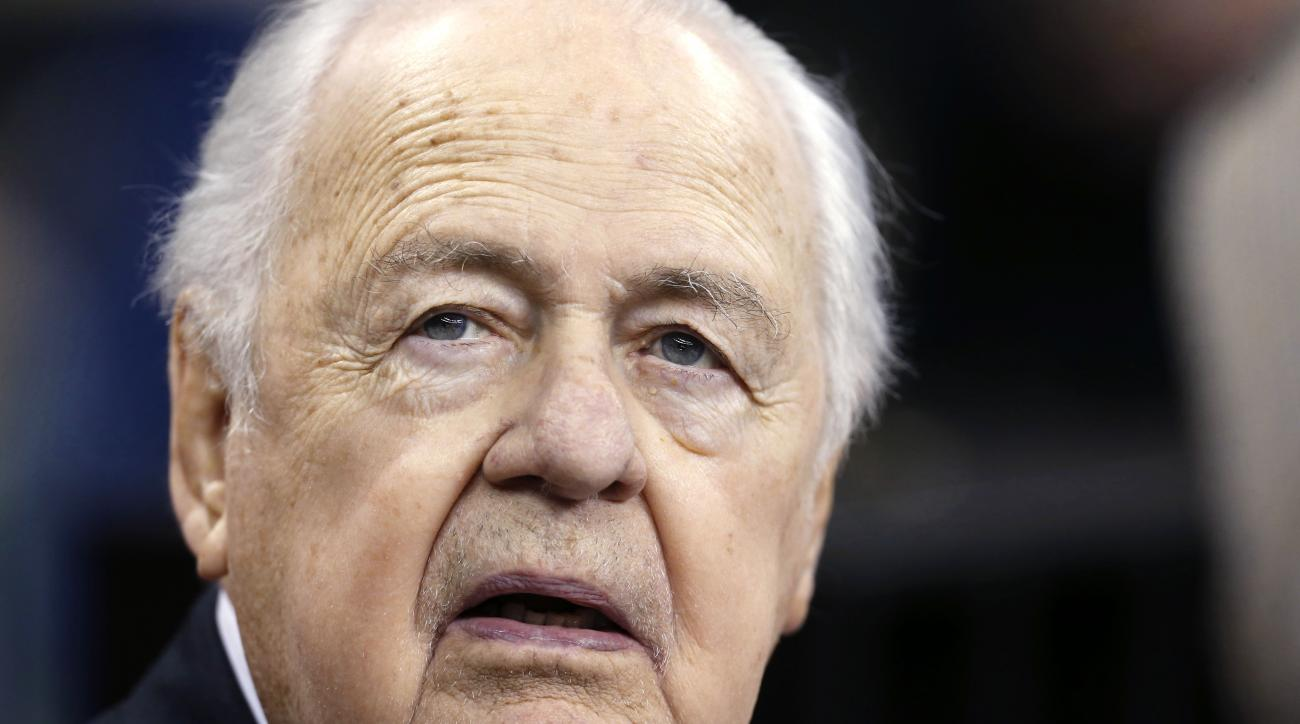 FILE - In this Sunday, Aug. 30, 2015 file photo, New Orleans Saints owner Tom Benson  watches from the sideline before an NFL preseason football game against the Houston Texans in New Orleans. The New Orleans Saints are denying allegations of racism and r